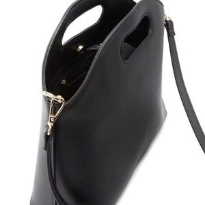 Black crossbody handbag with gold hardware